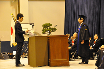 A student representative delivering a statement at the undergraduate student entrance ceremony