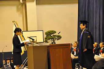 A student representative delivering a statement at the graduate student entrance ceremony