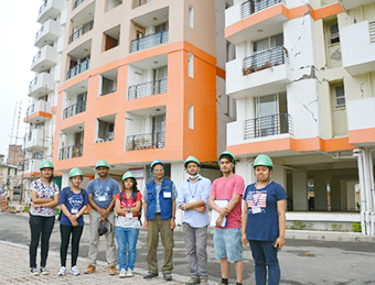 Field survey team at high-rise apartment building in Lalitpur with significant non-structural damage