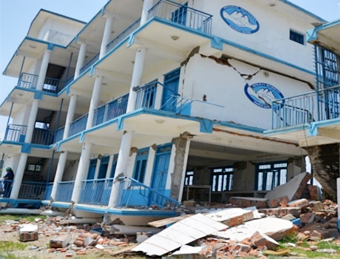 Collapsed four-story school building in Sangachowk, Sindhupalchowk district, with first-story columns at ground level