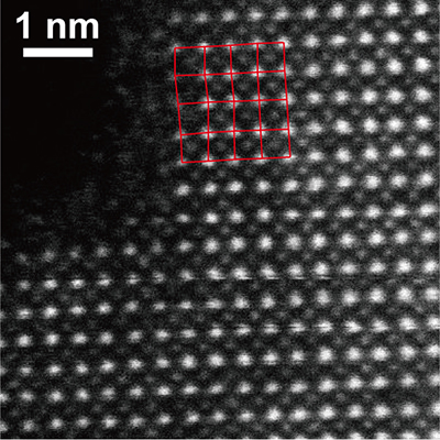 Electron microscope image of PbCrO3 where the lateral shift of Pb positions is evident.