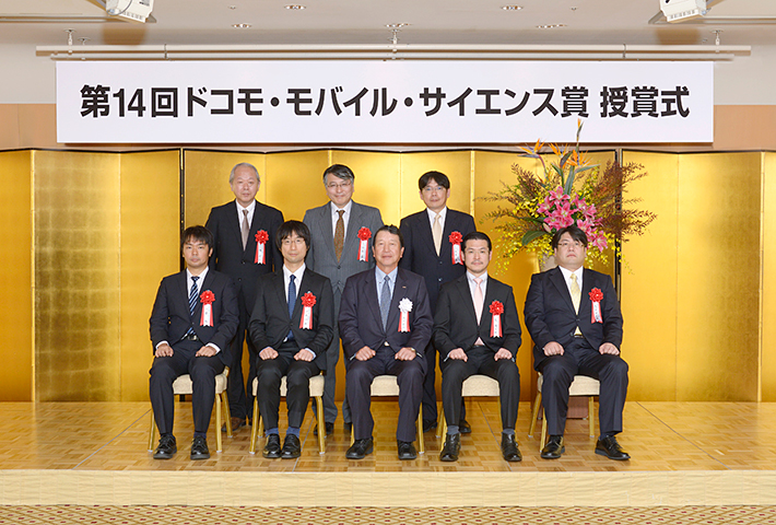 Photo of the award ceremony (In the front row, 2nd from the left, is Associate Professor Kawano)