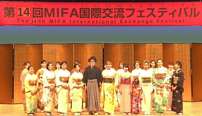 Elena in kimono (front, 2nd from right) at international exchange festival in 2019