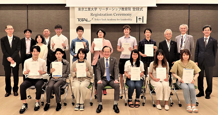 New students of June 2021 cohort, President Masu (front center), and faculty at live registration ceremony at Taki Plaza