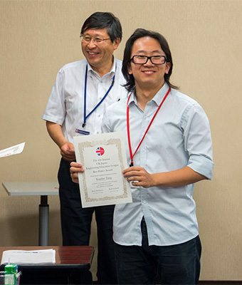 Yuanbo Tang (Tony) of the University of Oxford accepting a Best Poster Award
