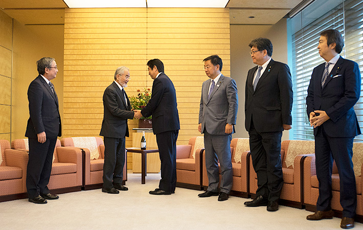 Shaking hands with Prime Minister Abe