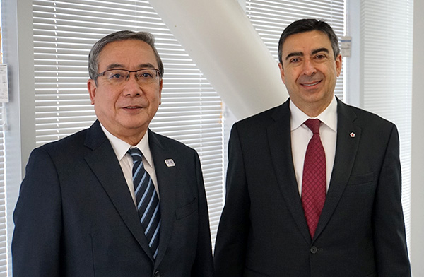 Deputy Head of Mission Pagé (right) with President Mishima