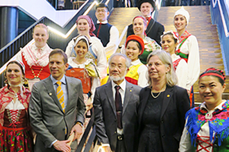 Group photo with people in traditional costume
