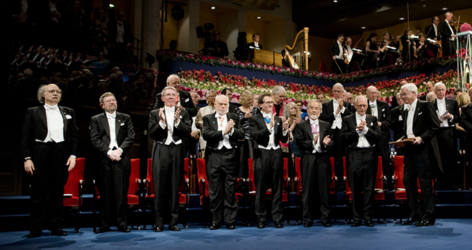 Nobel laureates at awards ceremony. From left: Physics laureates F. Duncan, M. Haldane, and J. Michael Kosterlitz; Chemistry laureates Jean-Pierre Sauvage, Sir J. Fraser Stoddart, and Bernard L. Feringa; Medicine laureate Yoshinori Ohsumi; Economic Sciences laureates Oliver Hart and Bengt Holmström © Nobel Media AB 2016. Photo: Alexander Mahmoud