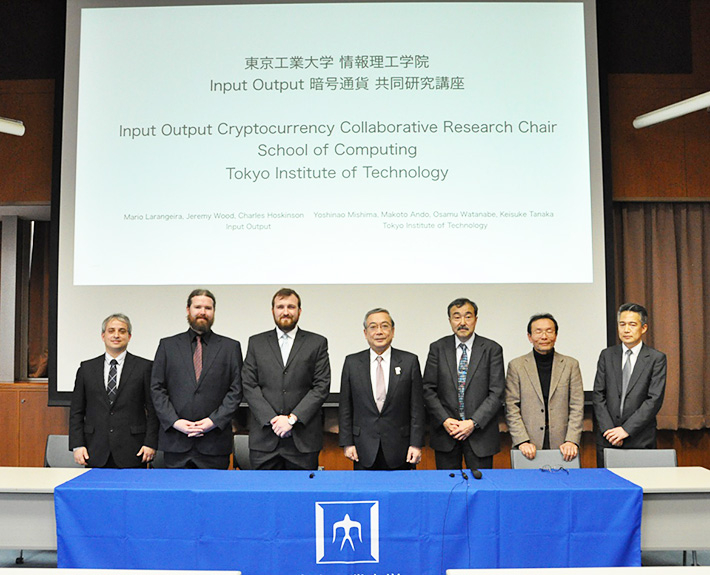 From left, Mario Larangeira (Specially Appointed Associate Professor of Tokyo Tech and Research Fellow of IOHK) ,  Feremy Wood (CSO and Co-founder of IOHK) ,  Charles Hoskinson (CEO and Co-founder  of IOHK), Yoshinao Mishima (President of Tokyo Tech),  Makoto Ando (Executive  Vice President of Tokyo Tech) ,  Osamu Watanabe (Dean of School of computing, Tokyo Tech) and Keisuke Tanaka (Professor of School of computing, Tokyo Tech)