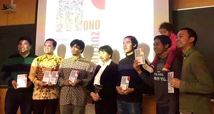 Participants showing their copies