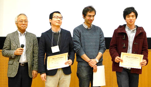 Vice President Mizumoto (far left) awarding poster presentations