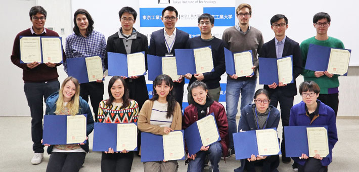 Winter Program participants display their certificates of completion