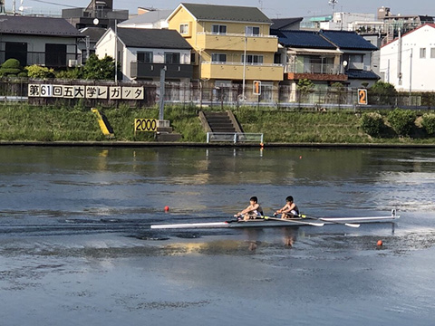 Double scull Ogiso (left) and Shirai guiding their white arrow to second place