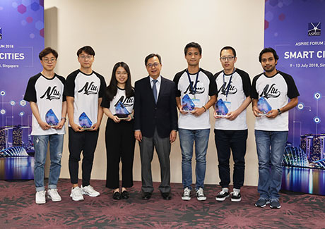 Yamada (third from right) and team with awards for Best Presentation, Student Workshop