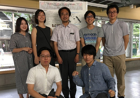 Yuan and Akama (back row, second and third from left) with host lab members during final poster presentation