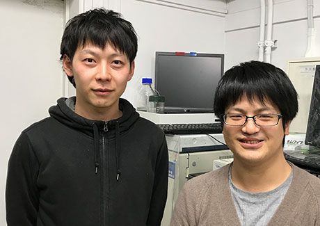 Lead author and Assistant Professor Fumitaka Ishiwari(left) and former master's student Gen Okabe in front of the high-performance liquid chromatography