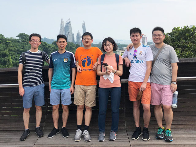 Ishisone (3rd from right) and lab members on a sightseeing trip