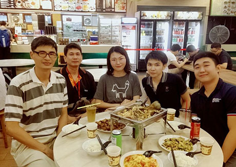 Ran (center) having lunch with lab members