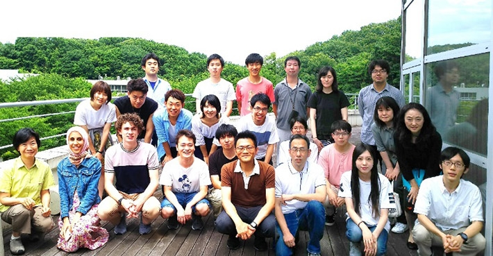 Cooper (front, third from left) with Kume lab members
