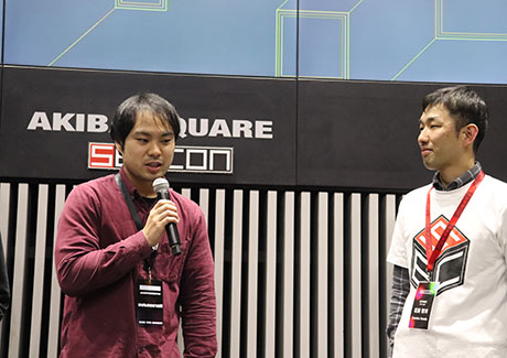 Kuroiwa (left) commenting after victory